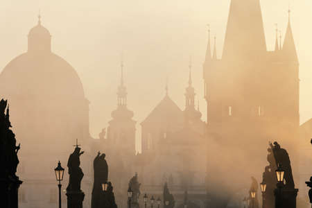 czech republic prague - charles bridge on foogy morning photo