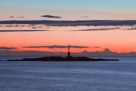 islet: croatia - colorful sky and clouds after sunset over islet with lighthouse