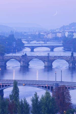 czech republic, prague - bridges over vltava river at morning light photo