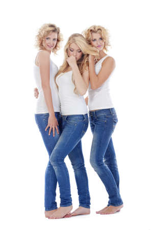 three young women in casual clothing standing - isolated on white Stock Photo - 8054578