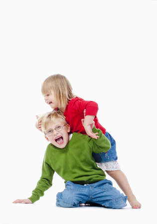 fooling: two young siblings fooling around with each other - isolated on white Stock Photo