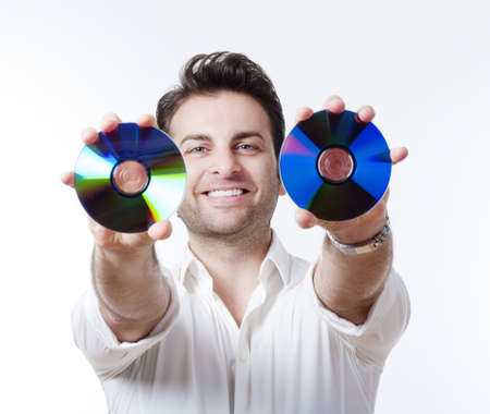 man in shirt standing smiling holding CD - isolated on white Stock Photo - 8349160