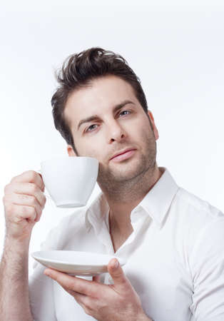 man in shirt holding cup of coffee looking up - isolated on white Stock Photo - 8349164