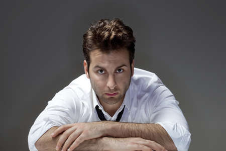 man in white shirt and tie looking, thinking - isolated on gray