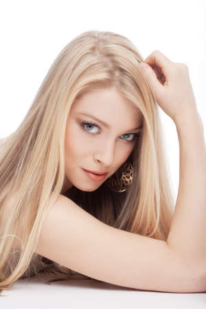 portrait of a young beautiful blond woman with blue eyes - isolated on white