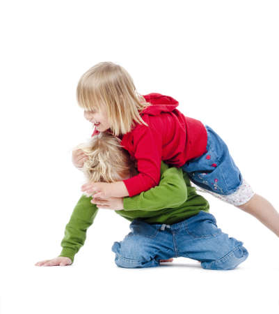 two young siblings fooling around with each other - isolated on white Stock Photo - 8561310