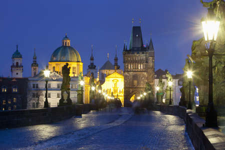 spires: czech republic prague - charles bridge and spires of the old town at dusk