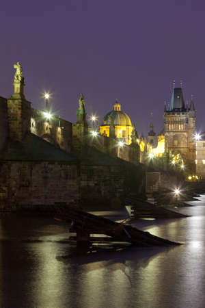 czech republic prague - charles bridge and spires of the old town at dusk photo