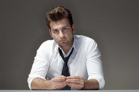 businessman in white shirt looking, thinking - isolated on gray Stock Photo