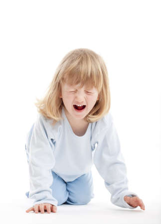 boy with long blond hair on the floor, screaming - isolated on white photo