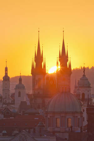 spires: czech republic, prague - spires of the old town and tyn church at sunrise