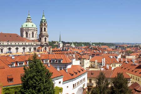 czech republic, prague - st. nicholas church at roofs of little quarter (mala strana) photo