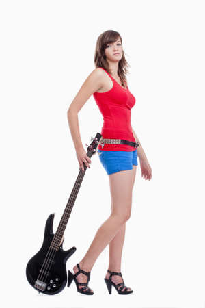 young female bass guitar player in red top - isolated on white photo