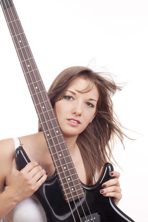 yuong female bass guitar player in red top - isolated on white photo