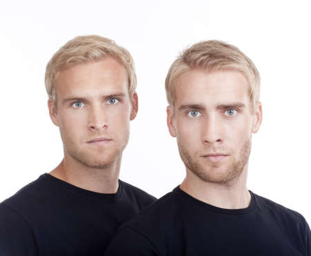 portrait of young twin brothers with blond hair and blue eyes - isolated on white Stock Photo