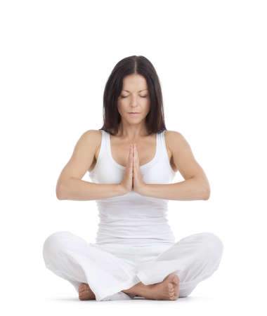 female pose: woman sitting on the floor exercising yoga - isolated on white