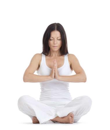 meditation isolated white: woman sitting on the floor exercising yoga - isolated on white
