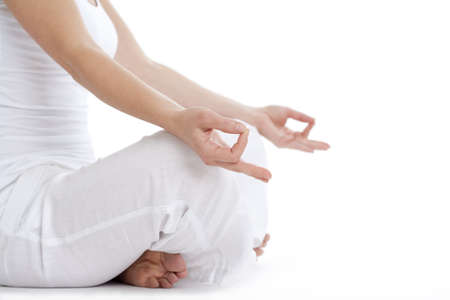 woman sitting on the floor exercising yoga - detail of hand - isolated on white