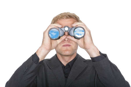 businessman in suit looking through binoculars reflecting sky- isolated on white photo