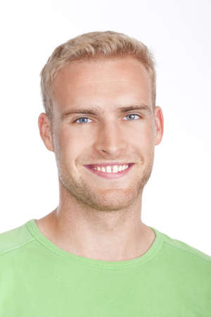 portrait of a young man with blond hair smiling - isolated on white