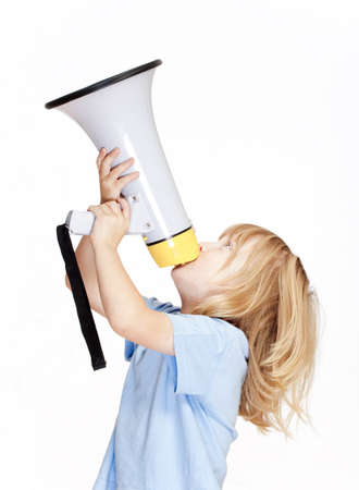 boy with long blond hair playing with a megaphone  photo