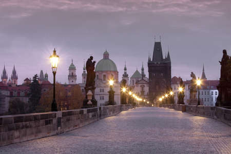 czech republic prague - charles bridge and spires of the old town at dawn photo