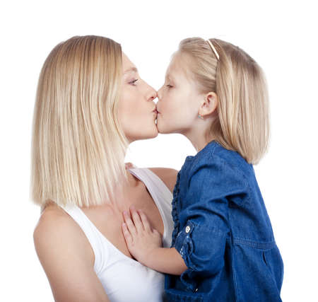mother and daughter with blond hair kissing - isolated on white