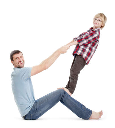 fooling: father and son having fun fooling around with each other - isolated on white