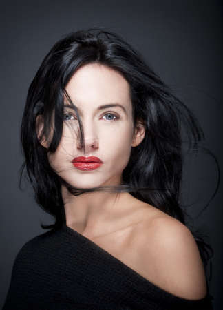 portrait of beautiful woman with dark hair and blue eyes