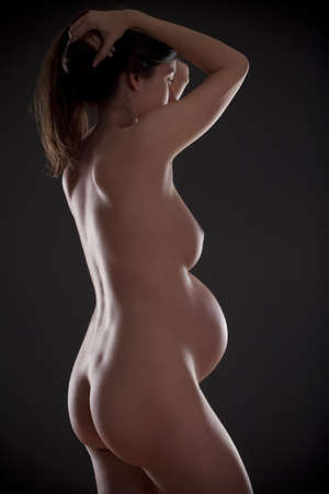 nude pregnant woman with long brown hair