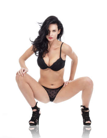 beautiful woman with dark hair in sexy black underwear - isolated on white