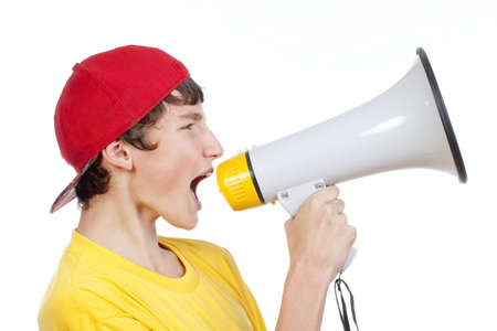 teenage boy in red baseball cap shouting in megaphone -isolated on white