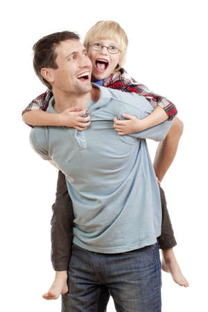 happy father giving his son piggy back ride - isolated on white photo