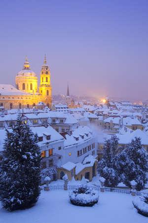 prague - st. nicolas church and rooftops of mala strana in winter Stock Photo