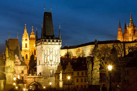 nicolas: czech republic prague - charles bridge tower and st  nicolas church at dusk Stock Photo