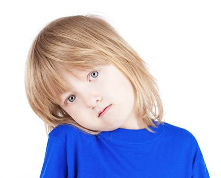 portrait of a boy with long blond hair in blue top - isolated on white photo