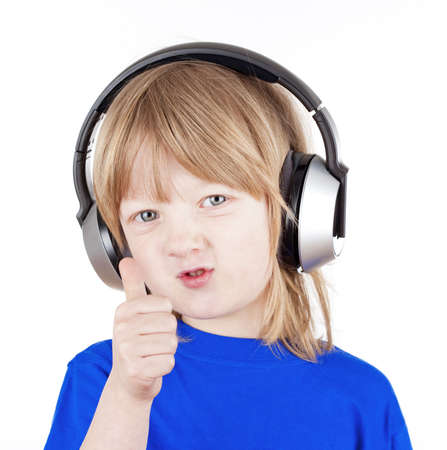 boy with long blond hair listening to music in headphones - isolated on white photo