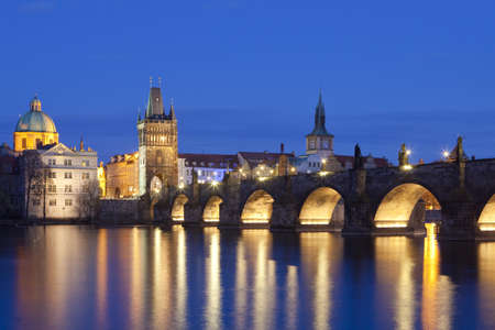 spires: czech republic, prague - charles bridge and spires of the old town at dusk
