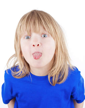 long tongue: boy with long blond hair sticking out his tongue - isolated on white Stock Photo