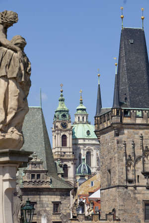 nicolas: prague - different architectural styles-st. nicolas church and charles bridge tower