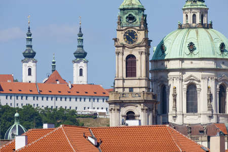 prague - st  nicolas clock tower and spires of strahov monastery at mala strana Stock Photo