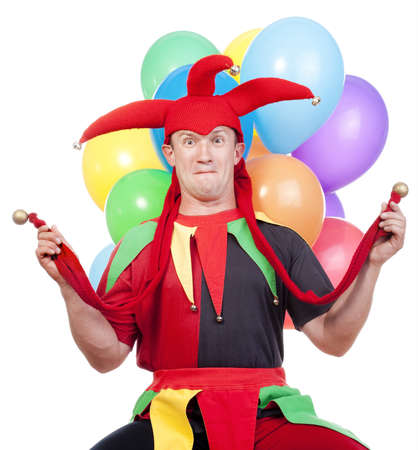 entertaining: jester - entertaining figure in typical costume with colorful balloons