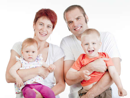 happy parents with their two children looking at the camera, smiling - isolated on white photo