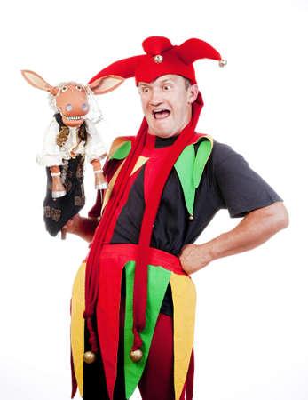 tonto: buf�n - la figura entretenido con el traje t�pico con t�teres Foto de archivo