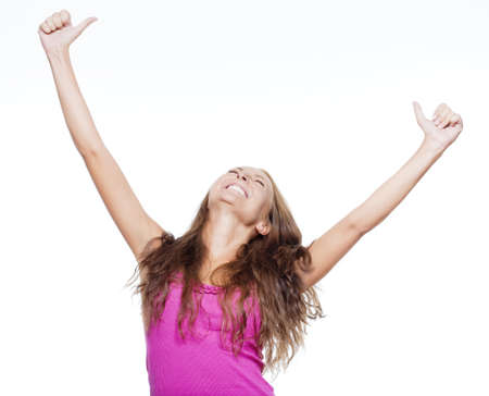 excited young girl showing both thumbs up screaming - isolated on white