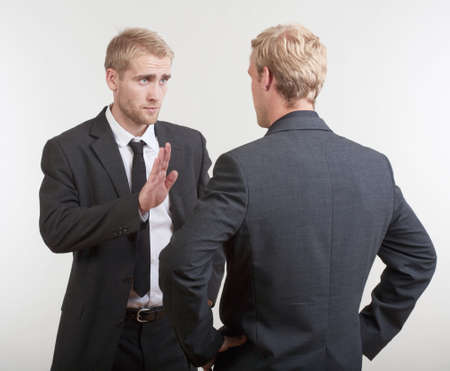 two you businessmen standing, discussing, arguing  photo
