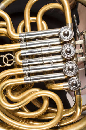 french horn: closeup of a concert french horn musical instrument Stock Photo