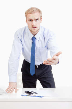 accusing: angry boss standing behind desk, gesticulating, accusing, blaming Stock Photo
