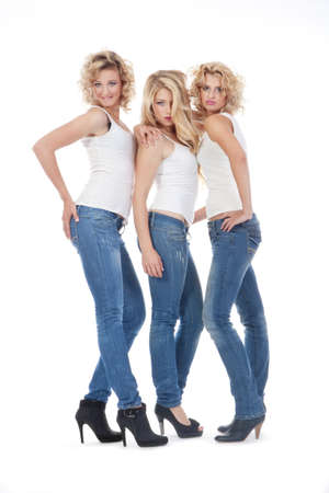 three young women in casual clothing standing - isolated on white  photo