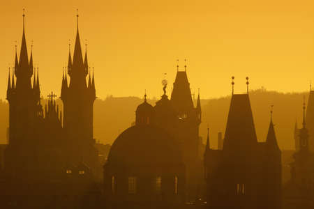 tyn: czech republic, prague - spires of the old town and tyn church at sunrise